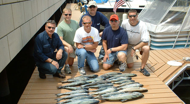 Customers displaying the haul of fish caught on the Blue Max